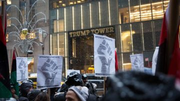 NEW YORK, NY - JANUARY 14: Black Lives Matter activists march in front of Trump Tower on January 14, 2017 in New York City.   Kevin Hagen/Getty Images/AFP == FOR NEWSPAPERS, INTERNET, TELCOS & TELEVISION USE ONLY ==